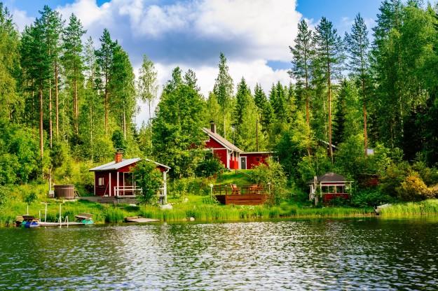 lake with log cabins