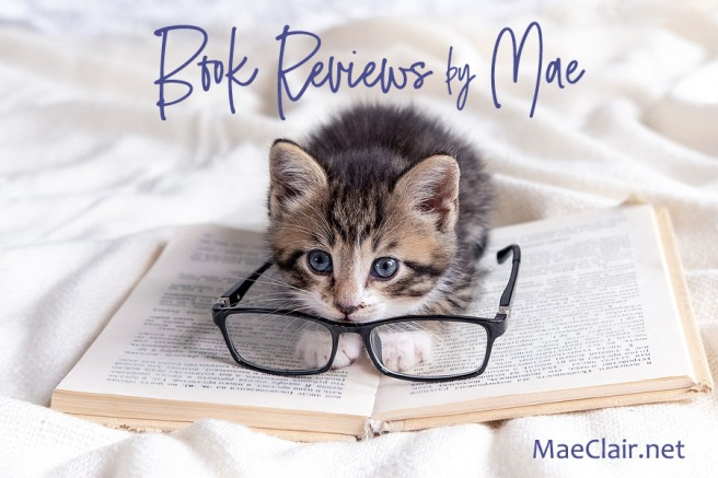 Cute striped kitten with open book and eyeglasses lying on white bed